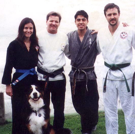 Happy faces. Courteney Cox and her husband wear KI Karate uniforms & belts